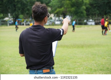 Strategy Male Coach or Team Manager drawing Plan or Pattern of Playing Soccer or Football as Diagram on Chart board as Strategy or Teamwork Coaching concept