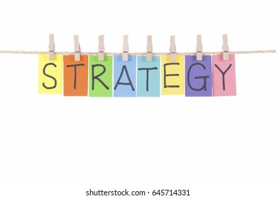 Strategy, paper words card hang by wooden peg