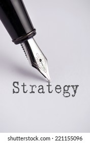 Strategy with pen written on paper