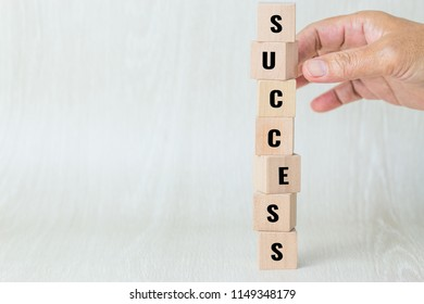 Strategy planning risk in business concept : Businessman or engineer placing wooden block dominos on table with letter e.g success. Ideas for alternative risk for goal. Copy space for text background