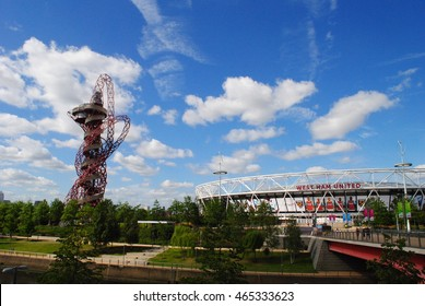 STRATFORD, LONDON - AUGUST 8, 2016: STRATFORD, LONDON - AUGUST 8, 2016: The Arcelormittal Orbit next to West Ham Football Clubs new stadium at the  Queen Elizabeth Olympic Park in Stratford, London.