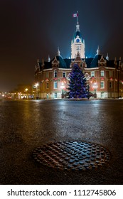 Stratford, Ontario / Canada - December 30, 2015: Christmas festivities in Stratford, Ontario with City Hall decorated in lights and Christmas tree in front.