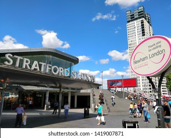 Stratford station entrance on a sunny day. Stratford train station next to Newham London sign. Stratford in Newham London. June 2018.
