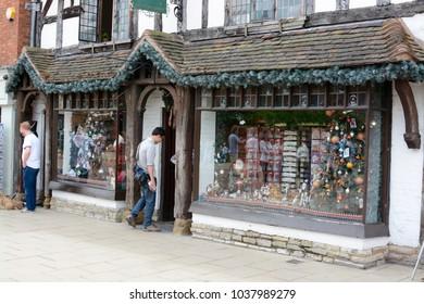 STRATFORD UPON AVON, UK - JULY 7, 2017: People shopping at the year round Christmas shop in Stratford Upon Avon high street, Stratford upon Avon, Warwickshire, England, UK