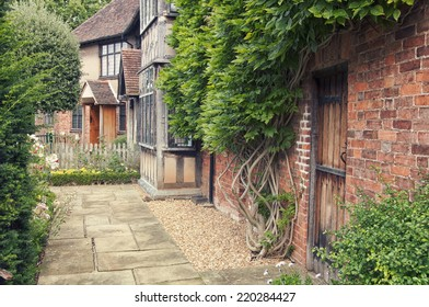 STRATFORD UPON AVON, UK - SEPTEMBER 2, 2014: Garden of the cottage where playwright and poet William Shakespeare was born. It is the major attraction in the city