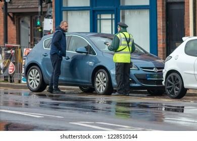 stratford upon avon warwickshire england UK November 8th 2018 civil enforcement officer and traffic warden argue about parking ticket in the street