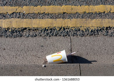 Stratford upon Avon Warwickshire  England UK March 3rd 2019 discarded mcdonalds cup on side of road with yellow lines