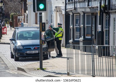 stratford upon Avon Warwickshire England UK March 24th 2019 traffic warden otherwise known as civil enforcement officer argues in the street with man who is just getting back into his car in time