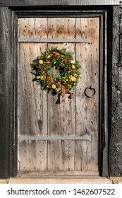 Stratford upon Avon/Warwickshire, England, UK - 12.08.2018: A traditional Christmas wreath on an Elizabethan (16C) oak entrance door and surround.