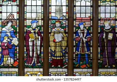 Stratford-upon-Avon, England - April 1, 2019: The Guild Chapel Stained Glass Window - center panel, The modern stained glass east window features notable Stratford characters