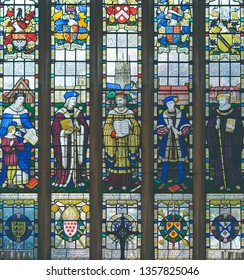 Stratford-upon-Avon, England - April 1, 2019: The Guild Chapel Stained Glass Window, The modern stained glass east window features notable Stratford characters
