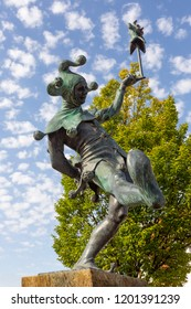 STRATFORD-UPON-AVON, ENGLAND - August 6, 2018: The Jester, a sculpture by James Butler RA, depicting the Fool in Shakespeare's plays, particularly Touchstone, in As You Like It