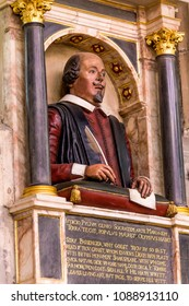 STRATFORD-UPON-AVON, UK - JUNE 8, 2015: Shakespeare's funerary monument on the wall above his grave in Collegiate Church of the Holy and Undivided Trinity. It is known r as Shakespeare's Church