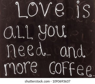 STRATFORD-UPON-AVON, UK - JUNE 8, 2015: Love is all you need... and more coffee. Blackboard advertising sign or customer stopper at sidewalk cafe
