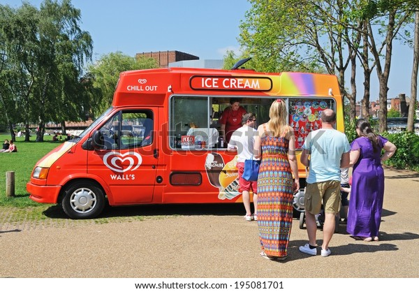 STRATFORD-UPON-AVON, UK - MAY 18, 2014 - People buying ice creams from an ice cream van, Stratford-Upon-Avon, Warwickshire, England, Western Europe, May 18, 2014.