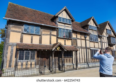 Stratford-upon-Avon, United Kingdom - 7 April 2017 - An unidentified man takes a picture of Shakespeare's birth house in Stratford-upon-Avon, United Kingdom on April 7th, 2017