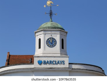Stratford-upon-Avon, Warwickshire, England, UK. 15 May 2018.  Cupola with copper roof and wind vane on top of a Barclays Bank.