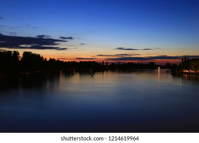 Stratus clouds and silhouette landscape with the reflection on the Allier river in Vichy, France