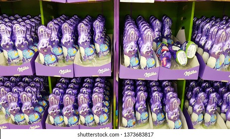 Straubing, Germany 14th April Milka chocolate Easter bunnies placed on the shelf in purple cartons with the Milka logo on them