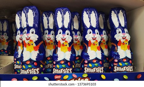 Straubing Germany 18th April, Chocolate bunnies with Smarties candies Easter edition, blue and white packing with Smarties logo on it