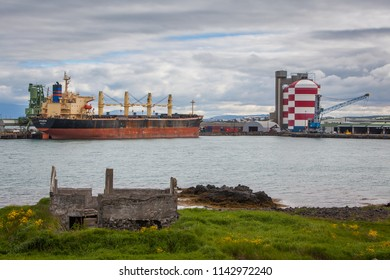 Straumsvik / Iceland - July 5, 2018 : Bulk carrier Apegon in port at Rio Tinto Alcan Aluminium smelter in Straumsvik, Iceland.