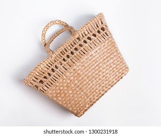 Straw bag basket isolated on the white background, top view