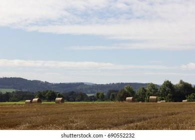 straw bale in stubble field in south german landscape in summer month august near stuttgart