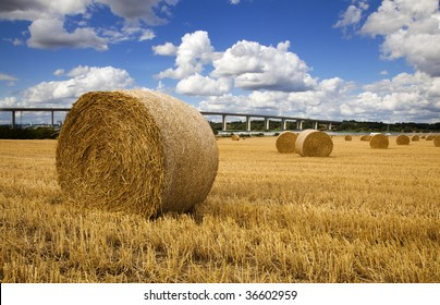 Straw bales with river and bridge in the Background