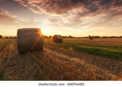 Straw bales and sunset
