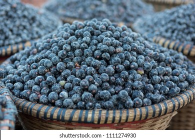 Straw basket full of fresh acai berries, grown in the Amazon rainforest, to sell at a fair in the city of Belém, Brazil.