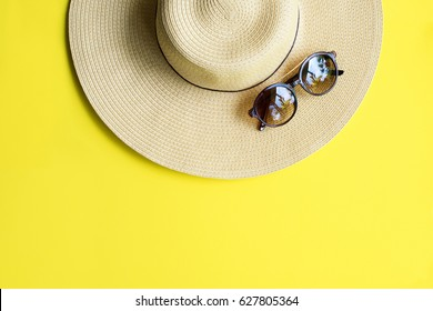 Straw Beach Woman's Hat Sun Glasses Top View Yellow Background Flat Single
