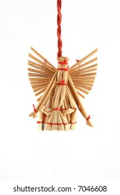 Straw christmas decoration hanging on red ribbon