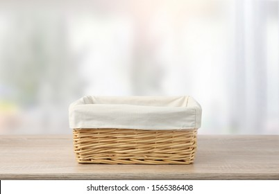 Straw empty basket decorated with white linen on wooden table,food advertisement template.Container. - Shutterstock ID 1565386408