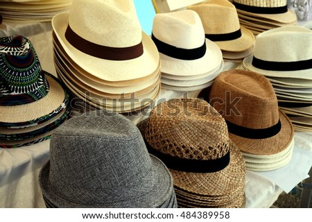 1a66ffab Straw fedora hats for men in varied colors and designs on a market stall
