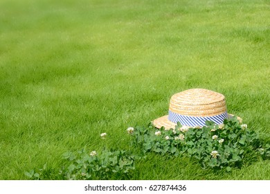 Straw hat in the green fields