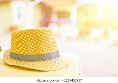 Straw hat on a hot day off on the table in the cafe