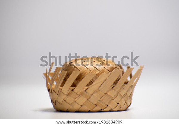 """Straw hat on a white background. Traditional object used in the June festivities in Brazil. Known as """"chapéu de palha"""""""