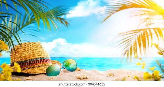 Straw hat and sun glasses on beach