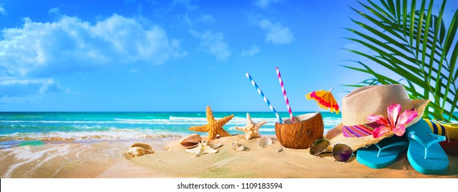26fbbb84d4e Straw hat and sunglasses on beach. Summer Holidays concept