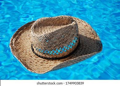 straw hat swimming pool holiday relax vacation blue water summer hotel resort skin care beach travel Swimmingpool uv skin care sunburn