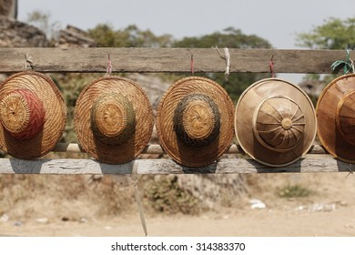 straw hats lined up