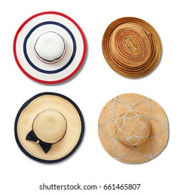 Straw hats with ribbon and bow on white background. Set beach hats summer accessory closeup top view isolated