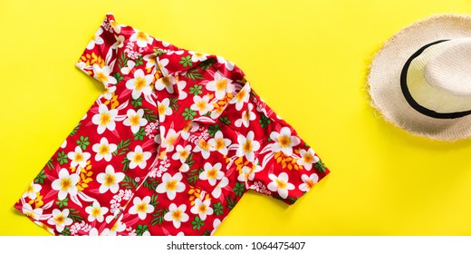 straw man's hat. songkran thailand festival skirt floral design. summer time top view flat lay yellow background copy space single banner concept
