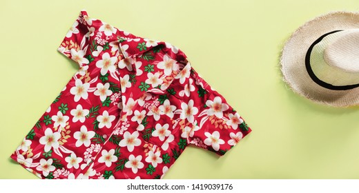 straw man's hat. songkran thailand festival skirt floral design. summer time top view flat lay green background copy space single banner concept