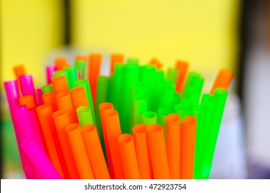 Straw plastic tube color full, selected focus