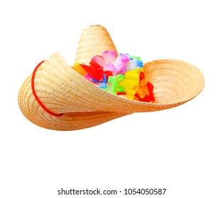 Straw sombrero with hawaian flowers isolated on white background.