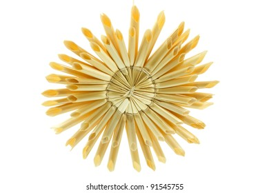 Straw star for a christmas tree on white background