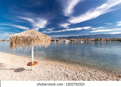 Straw umbrella on Croatian Beach, Town of Novalja