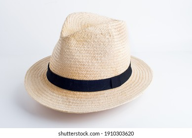 straw yellow hat with black ribbon on white background