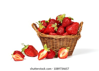 Strawberries and basket isolated on a white background.